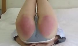 Hard Chinese spanking - paddle and carpet beater