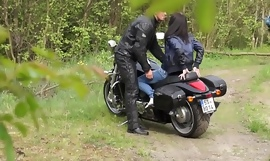 Muscled Biker Stretches Brunette's pussy outdoors