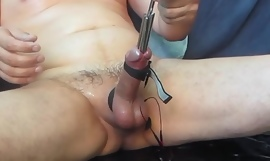 Eating Rope Cock Stuffing with a metal chain
