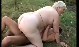 This is one of the hottest things that I think I have ever seen - fat granny fucked in a field by man in a mask
