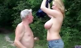 Stout huge titted slut shagging grandpa near a forest