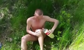 Combo unite totally naked and wanks in nature