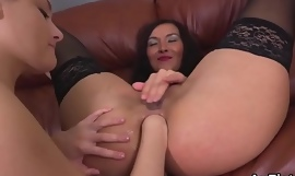 Sexy lesbian babes are opening thither and fist fucking anal holes