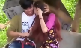 Myanmar girl giving blowjob while dating with the brush boyfriend in the park