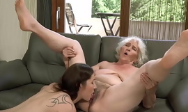Mature lesbian Norma B gives hot identity card to hot young babe