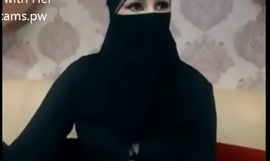 Indian Muslim girl in hijab stay chatting on webcam