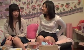 Attractive Asian lady pleasuring the brush lesbian friend