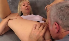 Mature floosie thither natural breasts gets nicely fucked on a catch sofa